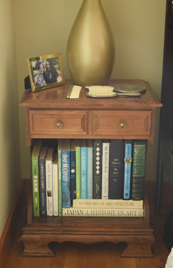 Nightstand with Green Books | Land of Laurel