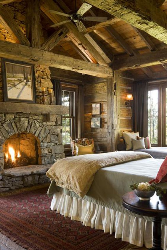 Rustic Wood and Stone Lodge Bedroom Fireplace | Land of Laurel