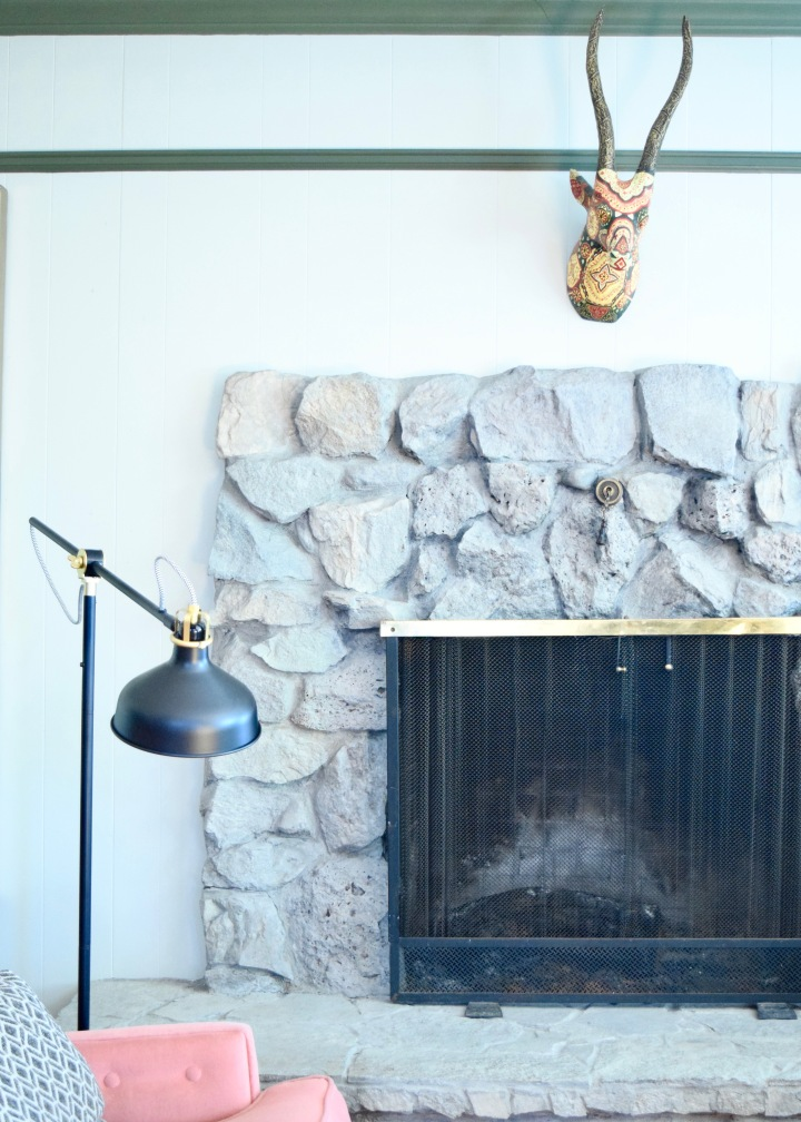 """Whitewashing"" A Stone Fireplace with Grey Paint"